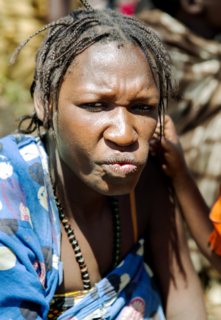 gatherer: AFRICA, TANZANIA, MAY, 10, 2016 - Portrait typical woman with bead decoration and african pigtails of the Hadzabe tribe. Hadzabe tribe threatened by extinction in Tanzania, Africa Editorial