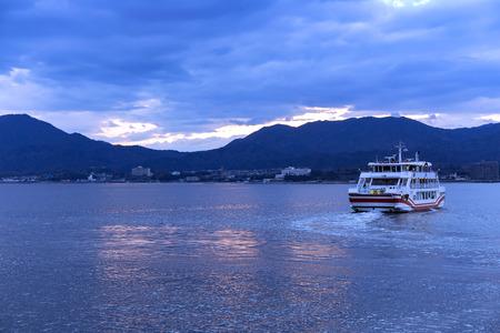 JAPAN, MIYAJIMA, APRIL, 06, 2017 - Ferry crossing between Miyajima Island and the city of Hatsukaichi in Hiroshima Prefecture in Japan. Editorial
