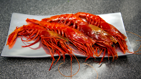 Red big king tiger prawns on silver plate cooked for dinner.