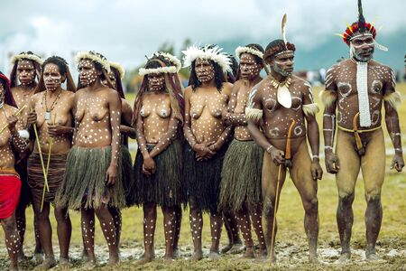 INDONESIA, PAPUA NEW GUINEA, WAMENA, IRIAN JAYA, AUGUST 20, 2018: Aborigines of local tribes gathered on the Baliem Valley festival in Wamena, Papua New Guinea. The festival usually attended by hundreds of peoples local tribes, all of them come with their