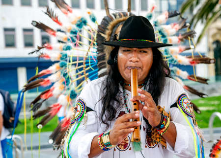 SPAIN, SAN SEBASTIAN, DONOSTIA, MAY, 12, 2017 - Peruvian Indian in a national costume plays on a pipe on the street of San Sebastian, Spain 에디토리얼