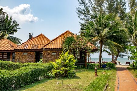 Small summer stone bungalows on the shore of the Gulf of Thailand on tropical Koh Chang island in Thailand. Stock Photo