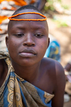 AFRICA, TANZANIA, MAY, 10, 2016 - Portrait young woman with bead decoration of the Hadzabe tribe. Hadzabe tribe threatened by extinction in Tanzania, Africa Editoriali