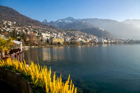 SWITZERLAND, MONTREUX, DECEMBER, 2015 - Panorama city of Montreux about of Lake Leman or Lake of Geneva with morning mist over the water surface. Editorial