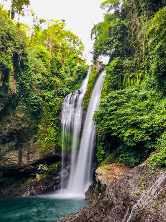 Aling Aling waterfall among the jungle in Bali, Indonesia Reklamní fotografie