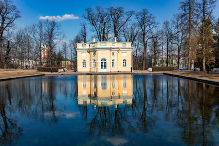 RUSSIA, SAINT-PETERSBURG, APRIL 24, 2011- The Catherine Palace was the Rococo summer pavilion of the Russian tsars and Great pond in the Catherine Park. Tsarskoye Selo, St.Petersburg, Russia