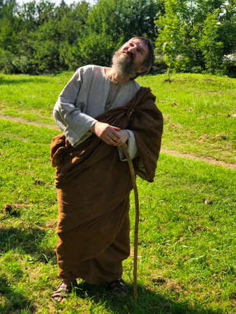 Actor in the guise of an ancient Greek philosopher on the set. Archivio Fotografico