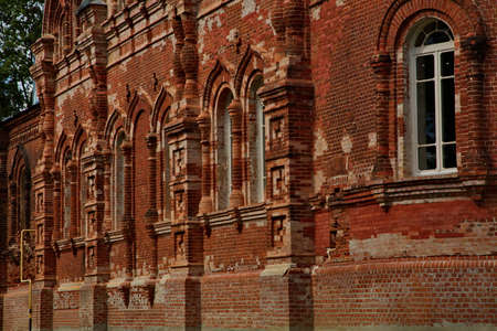 Old brickwork of the walls of an Orthodox church on the territory of the Vvedensky female island monastery.