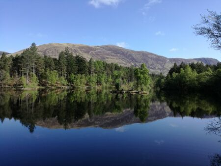 Beautiful mirror lake in Scottish Highlands