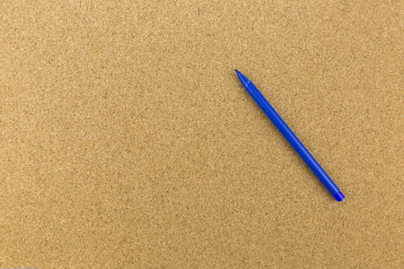 board marker: blue marker place on cork board