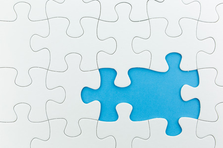 brainstorm: jigsaw puzzle use for business background such as teamwork brainstorm Stock Photo