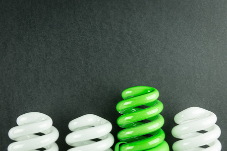 differentiation: Energy saving light bulbs business concept of Differentiation on black paper