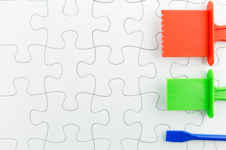 complete solution: jigsaw puzzle use for business background such as teamwork brainstorm Stock Photo