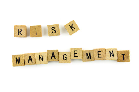 risk management: RISK MANAGEMENT word wooden alphabet blocks on white background from top view