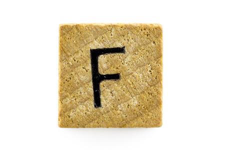 alphabet blocks: Wooden alphabet blocks with letters F (Isolated) Stock Photo