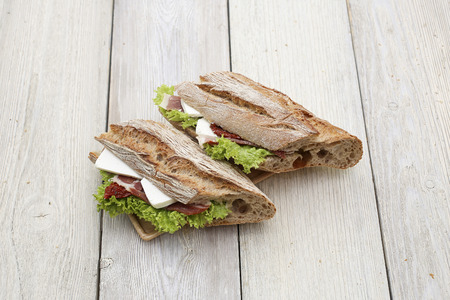 multi grain sandwich: Close up of sandwich on a wooden texture Stock Photo
