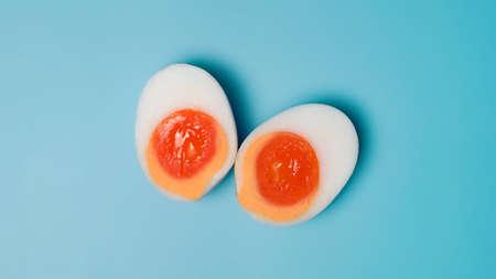 Boiled duck egg on blue background. 版權商用圖片