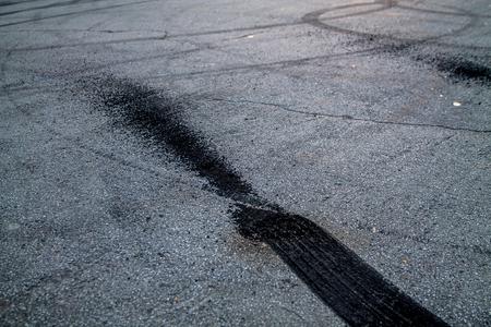 burnt rubber traces on asphalt