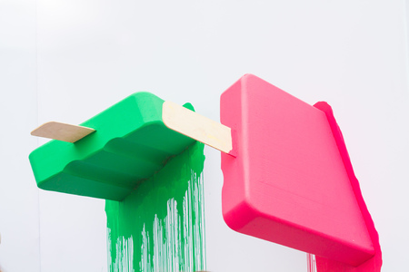 artificial colorful big popsicle stuck in a wall artificial colorful big popsicle stuck in a wall