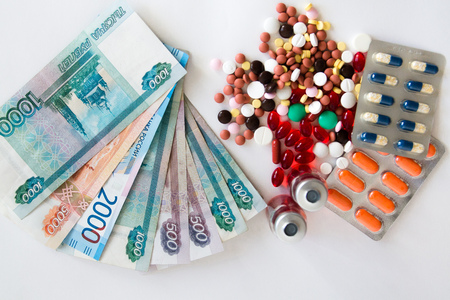 Business and healthcare concept, pills on Russian banknotes background