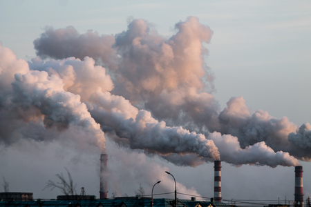 industrial chimneys with heavy smoke causing air pollution problem Standard-Bild - 114019713