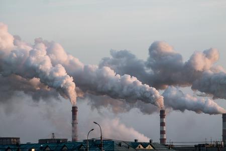 industrial chimneys with heavy smoke causing air pollution problem Standard-Bild - 114019715