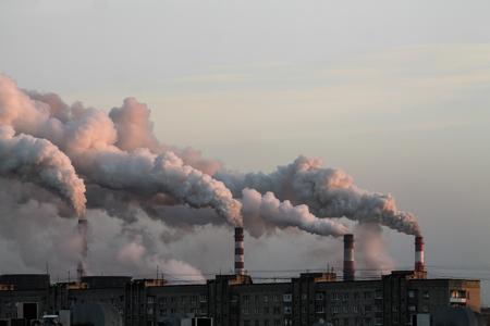 industrial chimneys with heavy smoke causing air pollution problem Standard-Bild - 114019831