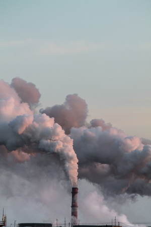 Vertical image of industrial chimneys with heavy smoke causing air pollution problem Standard-Bild - 114019838