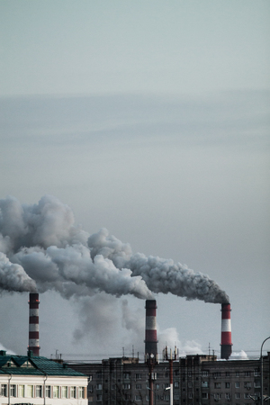 Vertical image of industrial chimneys with heavy smoke causing air pollution problem Standard-Bild - 114019973