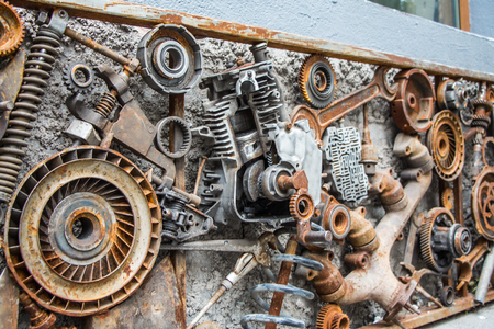 metal vintage machinery and engine parts gathered in patterns as a steampunk background Banco de Imagens
