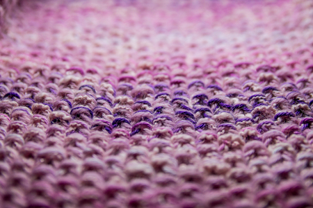 Pink, white and violet striped knitted texture background