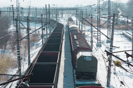 rail cars loaded with coal being transported from nearby mines to power plants in winter