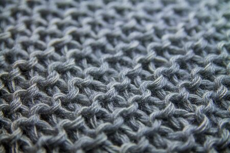 Perspective view of a gray handmade knitted pattern background