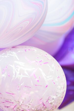 Vertical close up banner of purple and violet balloons as a background. Birthday background with ballons. Imagens