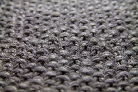 gray horizontal knitted pattern background with bokeh