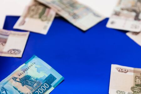 Russian money, ruble banknotes of one hundred and two thousand rubles on a dark blue background with copy space