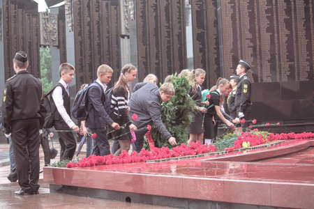 Khabarovsk, Russia - 09.02.2016: Students put flowers to memorial of eternal flame devoted to the memory of World War participants