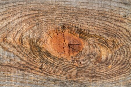beautiful extravagant wooden pattern on old wooden board with traces of snags on a flat surface as a background 스톡 콘텐츠