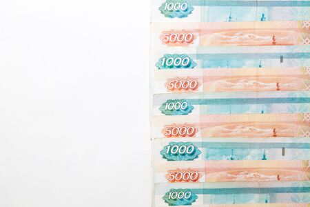 Copy space with Russian money banknotes rows of five thousand and one thousand rubles on white backround