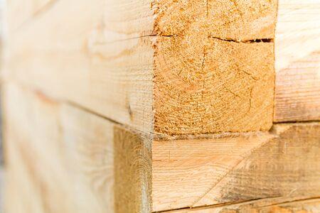 New light orange timber. Sauna building edge exterior. Wooden texture background. 免版税图像