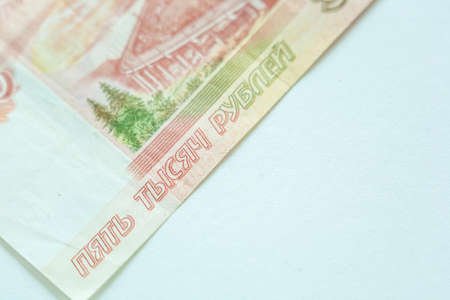 Russian 5000 rubles currency money on white background with copy space asa symbol of business and prospeity. Focus on number 5000 on red banknote Reklamní fotografie