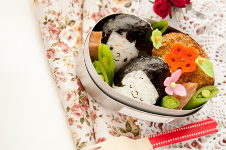 LuCould be in the rice ball, girl motif of lunch. Stock Photo
