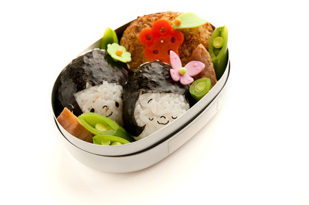 Could be in the rice ball, girl motif of lunch.