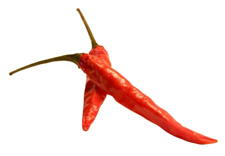 Two red hot peppers on a white background