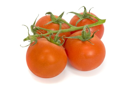 Red ripe tomatoes of cherry on a white background