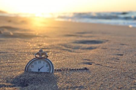 時間、時計、ビーチ 写真素材