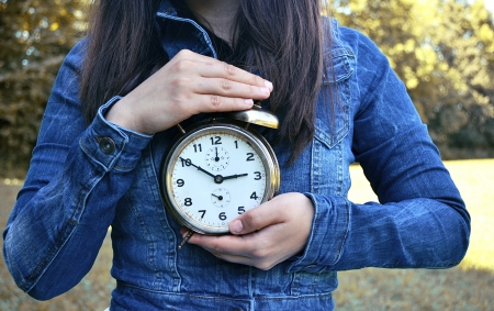 girl holding a clock photo