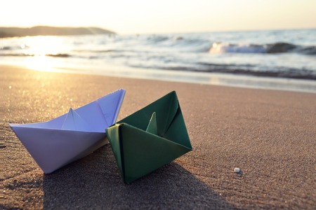 green and white paper boats on beach outdoors Stock fotó