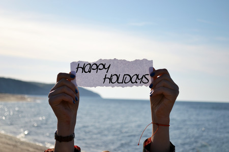 Happy Holidays card with a beach background Stock fotó