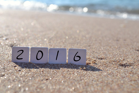 New year 2016 sign with seashells, starfish and christmas ball on a beach sand Stock fotó